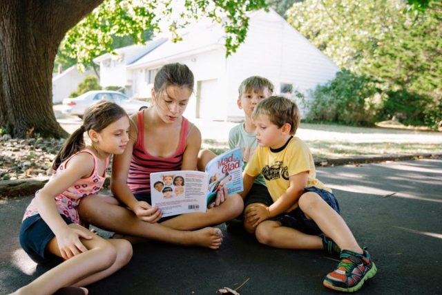 Kids reading Mad to Glad